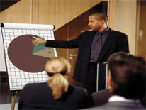 Man pointing to pie chart during presentation