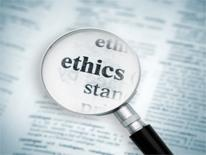 Magnifying glass with a display of the word ethics